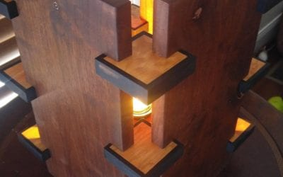 Walnut lamp with maple and ebony features.